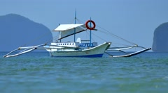 Tropical sea with anchoring boat Stock Footage