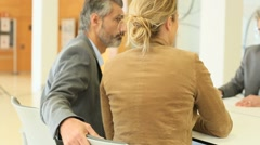 Couple signing financial contract at the bank Stock Footage