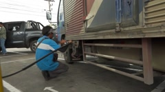 "Thai staff of fuel stations serve fueling cars, the fuel type call ""CNG"" Stock Footage"