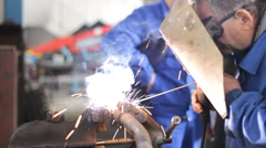 Welder man grinding at the factory working hard Stock Footage