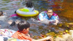 Kids enjoy playing waterfall at Nakhon nayok, Thailand Stock Footage
