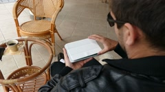 Male Model In Dark Jacket Looking At Ipad - Tablet Technology Internet Search Stock Footage