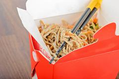 Meat and noodles in red take away container - stock photo