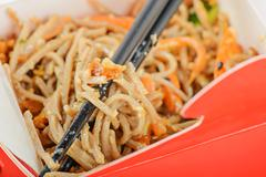 Noodles in red take away container Stock Photos