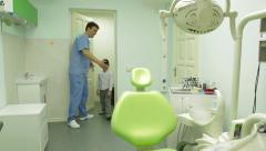 Young boy having a check up at dentist's surgery.  Stock Footage