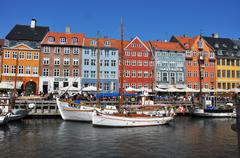 Nyhavn - The historic and colorful waterfront houses of Copenhagen, Denmark - stock photo