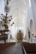 interior of bright scandinavian catholic church - stock photo