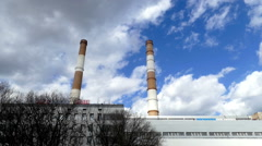 Two pipe heating plant on the background of the building and clouds Stock Footage