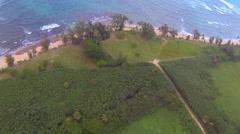 Aerial POV Swooping down towards ocean, North Shore, Oahu - stock footage