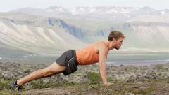Fitness sport man doing push-ups outside nature - Fit male sport model training Stock Footage
