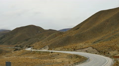 New Zealand South Island cars wind up moutain pass road Stock Footage