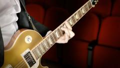 Playing electric guitar theater Stock Footage