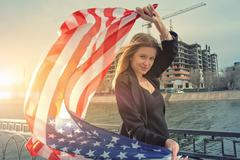 Young blond women posing with united states stars and stripes fl Stock Photos