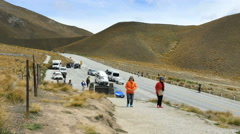 New Zealand South Island visitors in bright jackets on pass road Stock Footage