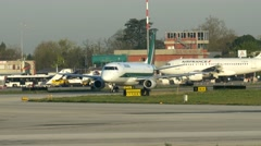 0668 UHD Alitalia commecial plane moving to runway - stock footage