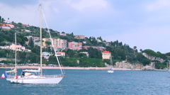 Sailing boat near coast in french riviera Stock Footage