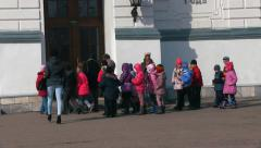 A group of children come into the building Stock Footage