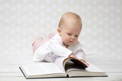 Baby with the book - stock photo