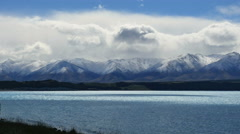 New Zealand Lake Pukaki clouds hover above mountains Stock Footage