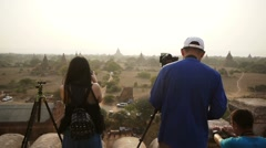 Tourists preparing to photograph a sunset over the temples of Bagan. Stock Footage