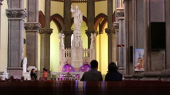 people visiting and praying in church - stock footage