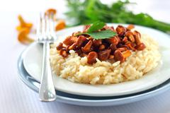 Risotto with chanterelles - stock photo