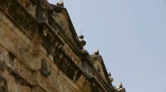 Birds flying near the top of an ancient temple. Stock Footage
