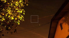 camera looking up with tree and residential roof stars nightsky - stock footage