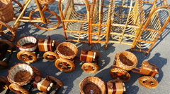 4K, Wicker toy tractors on sunny market. - stock footage