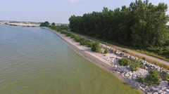 Low aerial view of green Lake Erie Algae along shore Stock Footage