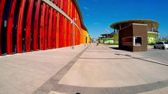Movement along the bright colored walls of a modern building Stock Footage