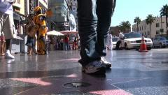 Mans feet standing around Joel McCrea hollywood Star in CA Stock Footage