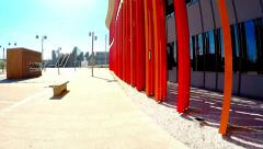 Movement along the bright colored walls of a modern building in sunny day Stock Footage