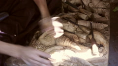 Detail of an artist's hands working on wooden carvings. Stock Footage