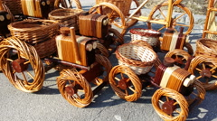 4K, Wicker toy tractors on sunny market Stock Footage