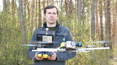Man drone operator  operate by copter  with camera. 4K 3840x2160 Stock Footage