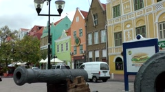 Stock Video Footage of Curacao Willemstad 022 waterfront street with Dutch houses behind old cannons