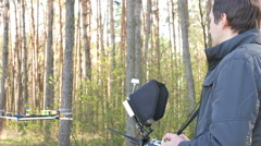 Man drone operator  holding  Transmitter in wood. 4K 3840x2160 Stock Footage