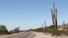 Stock Video Footage of Sonoran Desert, Arizona (Pt 2) - Car Driving on Desert Road with Saguaro Cactus