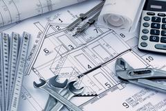 house plan with calculator - stock photo