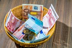 basket with money from donations - stock photo