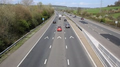 UK motorway traffic with cars lorries and vehicles travelling on major roadway M Stock Footage