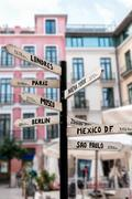Signpost with names of major cities worldwide Stock Photos