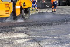 Asphalting roads Stock Photos
