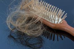 Hair brush with hair Stock Photos
