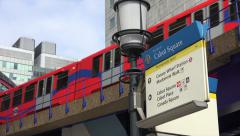 Docklands light railway passes Cabot Square, London financial district Stock Footage