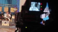 A man stands in the debates in TV studios. Live broadcast, media Stock Footage