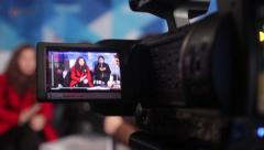 Stock Video Footage of The camera shoots people in the TV Studio. Live broadcast, media