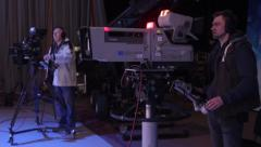 Cameramen at work in the TV Studio. Live broadcast, media Stock Footage