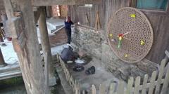 Locals working in village Stock Footage